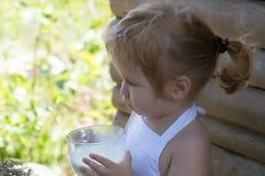 Cute little boy drinks milk Royalty Free Stock Photos