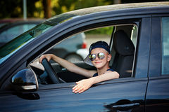 Cute little boy driving fathers car. Happy little boy  sitting in the car. Royalty Free Stock Images