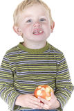 Cute little boy eating apple Royalty Free Stock Photo