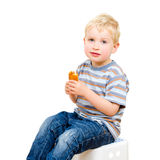 Cute little boy eating delicious cookie isolated Stock Photography
