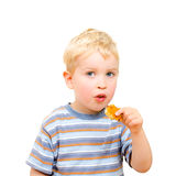 Cute little boy eating delicious cookie isolated Royalty Free Stock Image