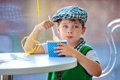 Cute little boy eating ice cream at indoor cafe Royalty Free Stock Photo