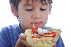 Cute little boy eating pizza Royalty Free Stock Image