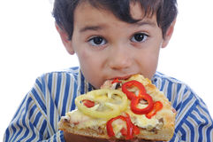 Cute little boy eating pizza Stock Photography