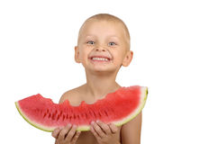 Cute little boy eating watermelon. Isolated on white background Royalty Free Stock Photo