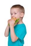 Cute little boy eats hamburger Stock Image