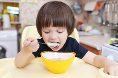 Cute little boy eats soup Stock Image