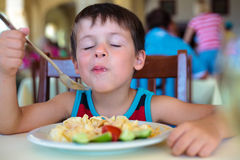 Cute little boy enjoying food Royalty Free Stock Photo