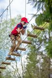Cute little boy enjoying his time in climbing adventure park stock photos