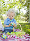 Cute Little Boy Enjoying His Easter Eggs Outside in Park Stock Image