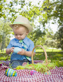Cute Little Boy Enjoying His Easter Eggs Outside in Park Royalty Free Stock Photography