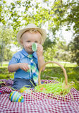 Cute Little Boy Enjoying His Easter Eggs Outside in Park Royalty Free Stock Photo