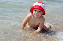 Cute little boy enjoying the sea Stock Images