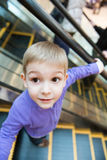 Cute little boy on escalator Royalty Free Stock Photography