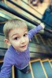 Cute little boy on escalator Stock Image