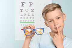 Cute little boy with eyeglasses in office. Cute little boy with eyeglasses in ophthalmologist office stock image