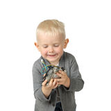 Cute little boy with fan from computer in hands focus on face Royalty Free Stock Photos