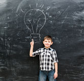 Cute little boy with finger up having an idea Royalty Free Stock Image