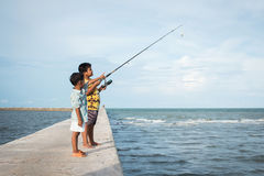 Cute little boy fishing Stock Photos