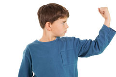 Cute little boy flexing his arm Royalty Free Stock Image