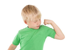 Cute little boy flexing his arm Stock Photography