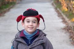 Cute little boy in a funny hat outdoor in aut Royalty Free Stock Image