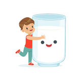 Cute little boy and funny milk glass with smiling human face playing and having fun, healthy childrens food cartoon Royalty Free Stock Photo