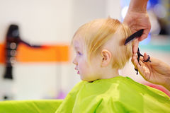 Cute little boy getting his first haircut Royalty Free Stock Photography