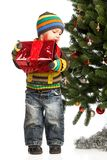 Cute little boy with gift near Christmas tree Stock Image