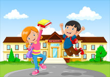 Cute little boy and girl with backpack and book on school building background Royalty Free Stock Photos