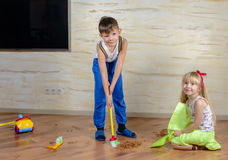 Cute little boy and girl cleaning up in the house Royalty Free Stock Image