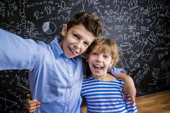 Cute little boy and girl in front of a big Stock Images