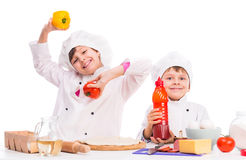 Cute little boy and girl with ingredients for pizza Stock Photography