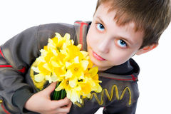 Cute little boy giving flowers Stock Images