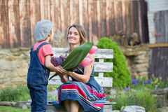 Cute little boy, giving present to his mom for Mothers day Stock Image