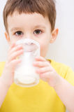 Cute little boy with a glass of milk Stock Image