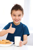 Cute little boy with a glass of milk Royalty Free Stock Images