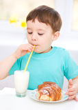 Cute little boy with a glass of milk Stock Images