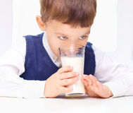 Cute little boy with a glass of milk Royalty Free Stock Photo