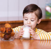 Cute little boy with a glass of milk Royalty Free Stock Image
