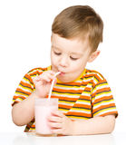 Cute little boy with a glass of milk Royalty Free Stock Photography