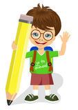 Cute little boy with glasses holding big yellow pencil Royalty Free Stock Photography