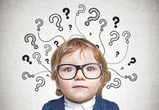 Cute little boy in glasses, question mark royalty free stock photography