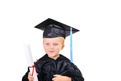 Cute little boy in graduation gown royalty free stock photo