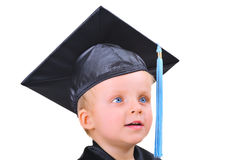 Cute little boy in graduation gown Royalty Free Stock Photos