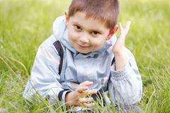 Cute little boy in grass Royalty Free Stock Photo