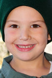 Cute little boy in green hat Royalty Free Stock Photos