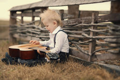 Cute little boy with guitar Stock Image