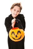 Cute Little Boy on Halloween. Cute little boy trick or treating on Halloween. Isolated on white stock photo