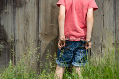 Cute little boy with the hand cuffs on his hands. Playing Royalty Free Stock Photos